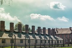 Chimneys of the buildings where the bodies of the dead Jews were burned in the concentration fields of Auschwitz and royalty free stock photography
