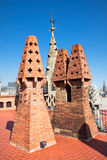 The chimneys and conical vents. Remembering small fir trees on roof of Palau's G�ell house, Gaudi's most important masterpieces in Barcelona, Spain stock images