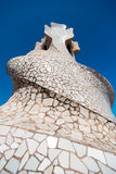 Chimneys covered with ceramic fragments that look like helmets a Royalty Free Stock Photo