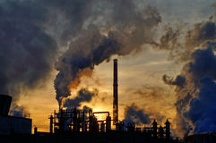 Chimneys and dark smoke over chemical factory Stock Photo
