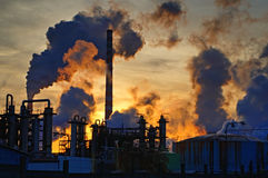 Chimneys and dark smoke over chemical factory Royalty Free Stock Photography