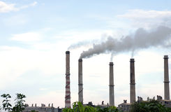 Chimneys with dense smokes Stock Images