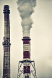 Chimneys with dramatic  smoke Stock Image