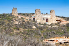 Chimneys of dwelling  houses built into mount. Chinchilla Royalty Free Stock Photography