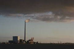 Chimneys from a heating plant viewed from Island of Fanoe in Den Royalty Free Stock Image