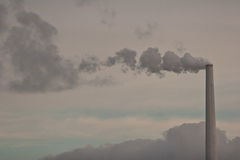 Chimneys from a heating plant viewed from Island of Fanoe in Den Royalty Free Stock Photos