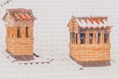 The chimneys of a house during a heavy snowfall. The snowflakes come down thick and cover the chimneys of a house Royalty Free Stock Photography