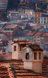 Chimneys and houses. Chimneys on a roof, in front of typical Balkanic houses in Veliko Turnovo Royalty Free Stock Image