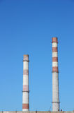Chimneys  large plant against the blue sky Royalty Free Stock Photo