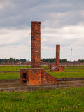 Chimneys left in ruins of Birkenau concentration camp Royalty Free Stock Image