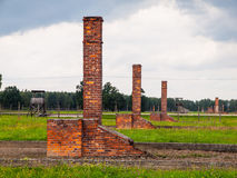 Chimneys left in ruins of Birkenau concentration camp Royalty Free Stock Images