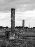 Chimneys left in ruins of Birkenau concentration camp Stock Images