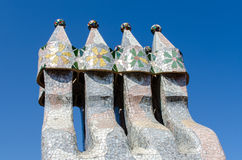 Chimneys like masked soldiers on the roof of La Pedrera or Casa Stock Image