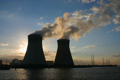 Chimneys of nuclear power plant. In time of sunset Stock Image