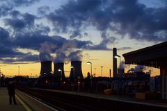 Chimneys of nuclear power plant at dusk Royalty Free Stock Image