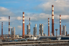 Chimneys of oil refinery. Chimneys and buildnig of oil refinery Stock Photography