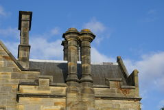 Scotney Castle in Lamberhurst, England. Old castellated roof with chimneys or chimney stacks and pots Stock Photos