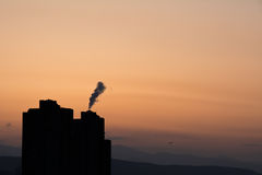 Chimneys polluting air Stock Images