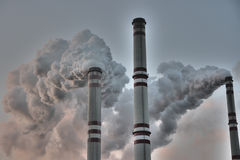 Chimneys Poluting The Planet - Global Warming Stock Images