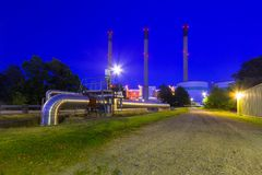 Chimneys of power plant at Baltic sea. Coast, Sweden Royalty Free Stock Image