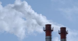 Chimneys of Power Plant. At blue sky stock video footage