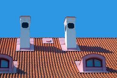Chimneys on red roof. Royalty Free Stock Images