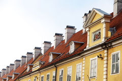 Chimneys and red-tiled roofs of  building in Old Riga Royalty Free Stock Image
