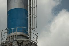 Chimneys release heat and pollution to the atmosphere in the factory stock photo