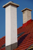 Chimneys on the roof. Chimney on the roof of the new stock photo