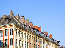 Chimneys on a roof, Lille (Nord, France). Royalty Free Stock Image