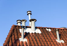 Chimneys on roof Stock Image