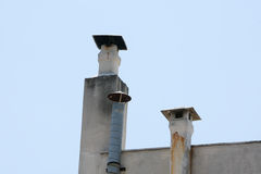 Chimneys on a roof top Stock Images