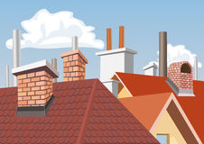 Chimneys on the roofs of houses Royalty Free Stock Photography