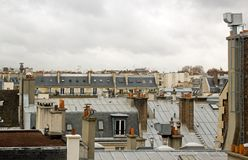 Chimneys in the roofs of Paris Stock Photos