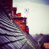 Chimneys and rooftops. Chimneys on roofs going into the distance Stock Photography