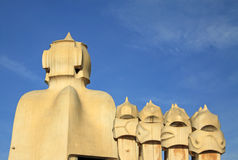 Chimneys shaped anthropomorphic soldiers on the terrace of the Casa Mila or La Pedrera building. BARCELONA, CATALONIA, SPAIN Stock Photos