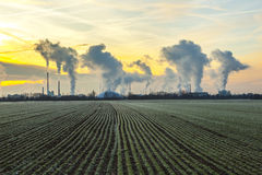 Chimneys and smoke of industry plant Stock Photography