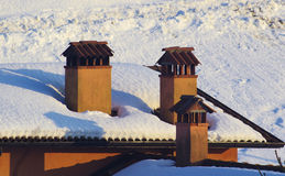 Chimneys and snow. Stock Photo
