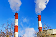 Chimneys with steam production of a thermal power station Stock Image