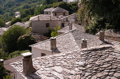 Chimneys on stone roofs Royalty Free Stock Image
