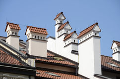 Chimneys on tiled roof Stock Image