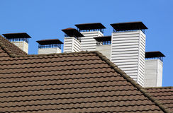 Chimneys on tiled roof Stock Photo