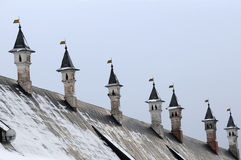 Chimneys of the Tzar Palace. Roof and chimneys of the Tsar Palace in the convent in Zvenigirod in Rusia in the winter Stock Image