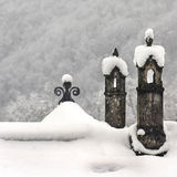 Chimneys under the white snow. Two chimneys in a snowy winter day covered by soft white snow Royalty Free Stock Photo