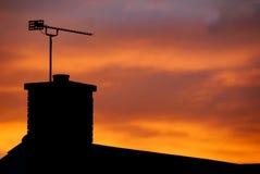 Chimneystack solnedgång Arkivbild
