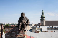 Chimneysweep monument on the roof in the Lviv, Ukraine. Stock Photos