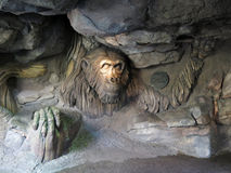 Chimpanzee. Face carving on tree stock photography
