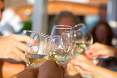 A chin-chin with white wine glasses Stock Image