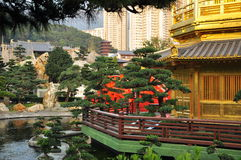 Chin Li nunnery and gardens, Hong Kong. The Chin Li nunnery and temple in Hong Kong Diamond Hill. View of the temple, gardens and housing buildings in the stock photography