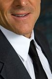Chin Man. Close up of businessman's chin and lower face while wearing a coat and tie and white shirt Stock Photos